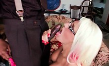 Slutty mom in glasses blowing huge black cock at home