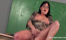 Dirty mature teacher giving BJ and masturbating on the desk